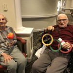 Blanche and John showing off the crafts they helped created to decorate our olympic games.