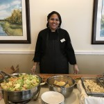 Keisha serving the community Italian lunch.
