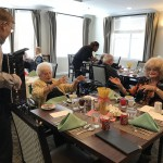 Residents dancing and enjoying live music.