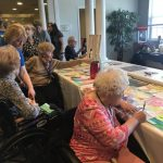 Residents voting for their favorite pieces of art.