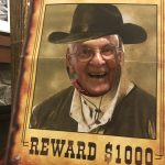 Uh oh, Mr. Hill is wanted. $1,000 reward for anyone who finds this cowboy.